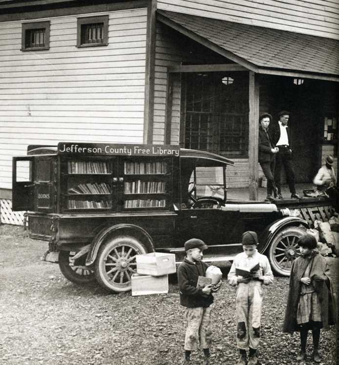 The Free Library bookmobile stops at the Sayre commissary station in the 1920s