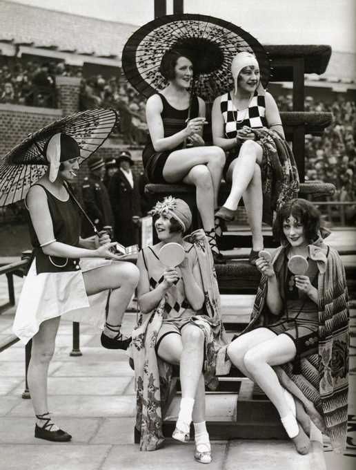 Wanton British harlots, unabashedly modeling 1928's latest swimsuits, powdering their noses, and smoking