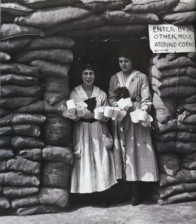 Lady volunteers clutch tea mugs in a London YMCA dugout, erected as an air raid shelter in WWI--Readers Digest UK