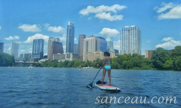 My gorgeous and fit friend, Brenda, paddleboarding, with view of Austin skyline