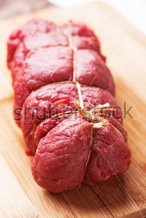 stock-photo-raw-beef-meat-tied-with-rope-ready-to-be-cooked-107906717