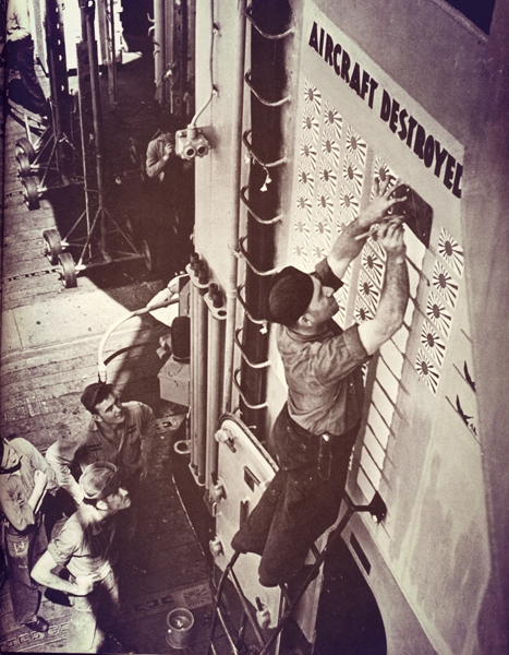 WWII sailor painting a fresh kill on the carrier scoreboard (Time-Life)