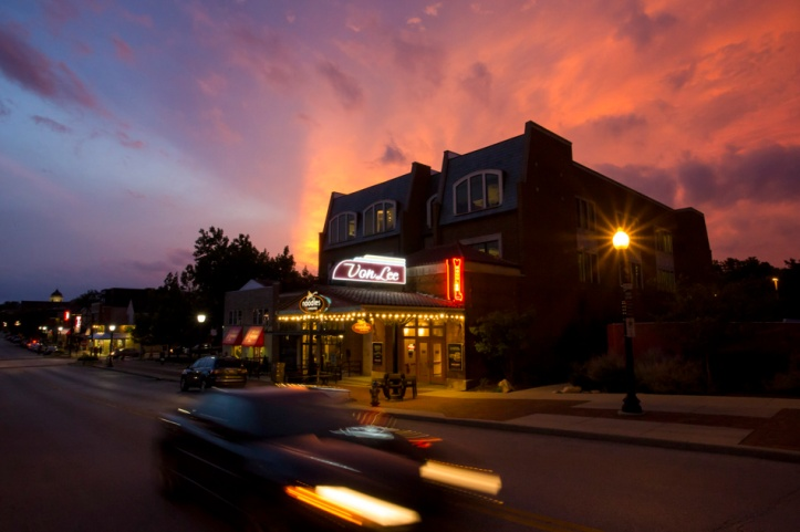 The sun sets behind Bloomington's historic Von Lee building on Monday, July 13, 2015. Formerly a theater, the Von Lee now houses IU Communications on the second and third floors. (James Brosher/IU Communications)