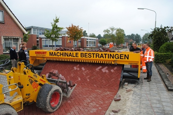 http://inhabitat.com/amazing-brick-machine-rolls-out-roads-like-carpet/