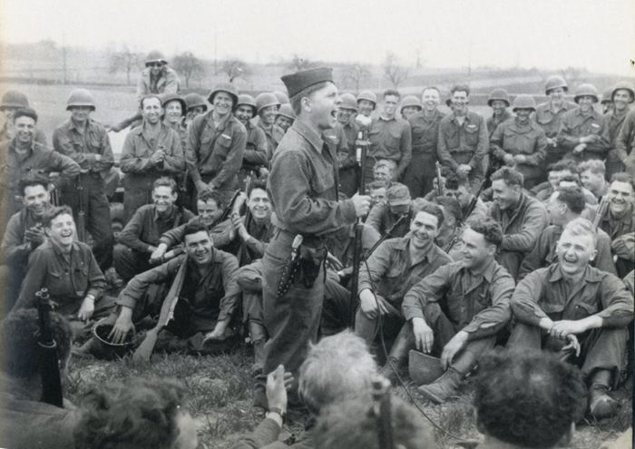 PFC Mickey Rooney entertains infantrymen in Germany, April 1945