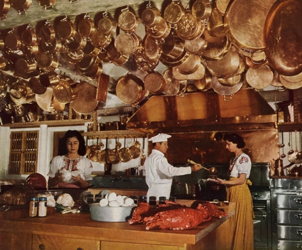 Swan Lake Ranch, Alcalde, New Mexico, 1949. Owner Mrs. Hamilton Garland collects copperware.